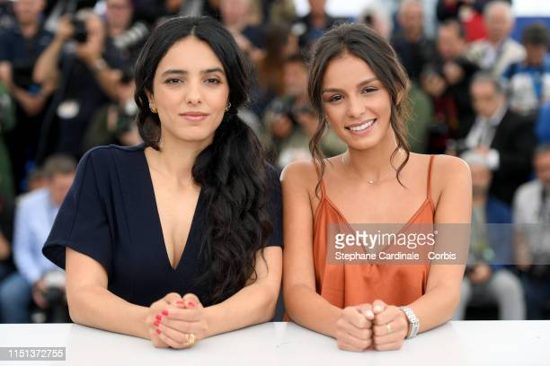 Hafsia Herzi and Meleinda Elasfour attend thephotocall for Mektoub My Love Intermezzo during the 72nd annual Cannes Film Festival on May 24 2019 in...