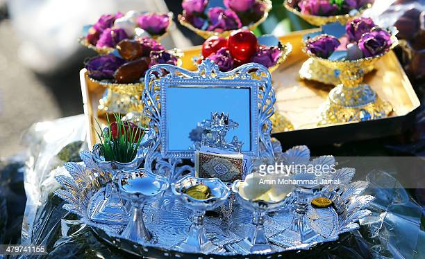 Haft Sin is set out on a small table to celebrate Nowruz the Persian New Year on March 20 2014 in Tehran Iran Nowruz is calculated according to a...