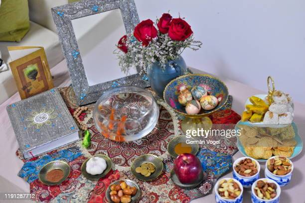 haft-sin iranian new year nowruz tablespread - nowruz stock pictures, royalty-free photos & images