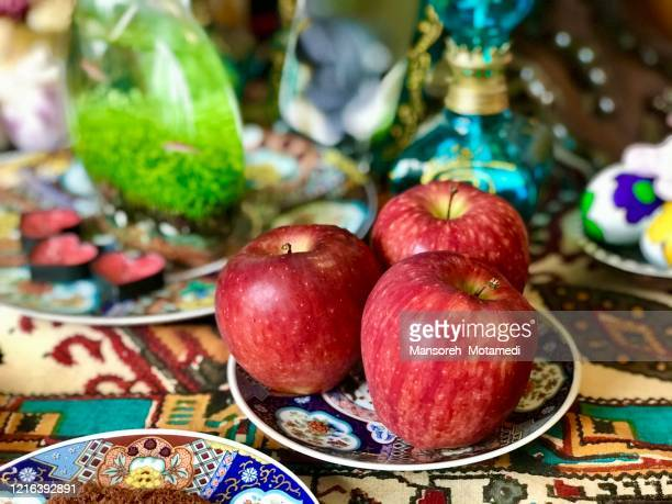 haft-sin symbolism - nowruz stock pictures, royalty-free photos & images