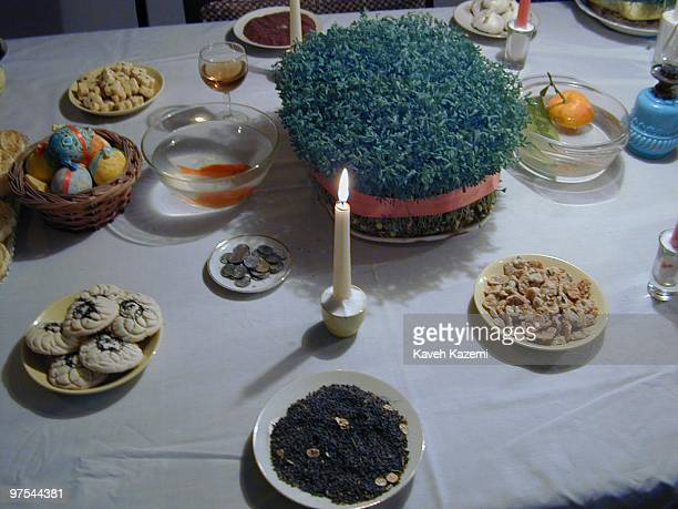 A HaftSin table furnished with the traditional seven symbolic items each beginning with the Persian letter S Tehran Iran 21st March 2002 HaftSin is a...