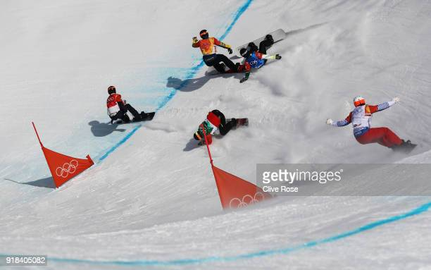 Hagen Kearney of the United States leads the pack as Lluis Marin Tarroch of Andorra Adam Lambert of Australia collide during the Men's Snowboard...