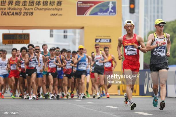 Hagen Pohle of Germany and Wang Kaihua of China in action during Men's 20 kilometres Race Walk of IAAF World Race Walking Team Championships Taicang...