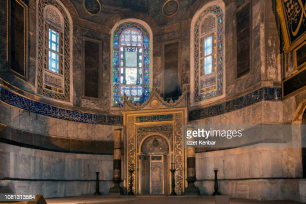 hagia sophia apse and latter added ottoman mihrab, flanked with two big candled - latter stock pictures, royalty-free photos & images