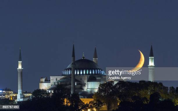 Hagia Sophia at night with crescent moon in the sky in Istanbul Turkey on August 25 2017