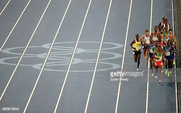 Hagos Gebrhiwet of Ethiopia leads the pack in the Men's 5000m Final on Day 15 of the Rio 2016 Olympic Games at the Olympic Stadium on August 20, 2016...