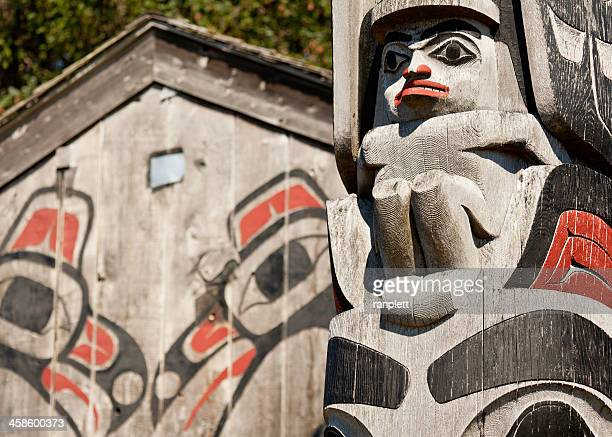 haida gwaii totem pole and longhouse - totem pole stock pictures, royalty-free photos & images