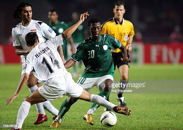Haidar Abdul Amer of Iraq and Ahmed Al Mousa of Saudi Arabia in action during the AFC Asian Cup 2007 final between Iraq and Saudi Arabia at Gelora...