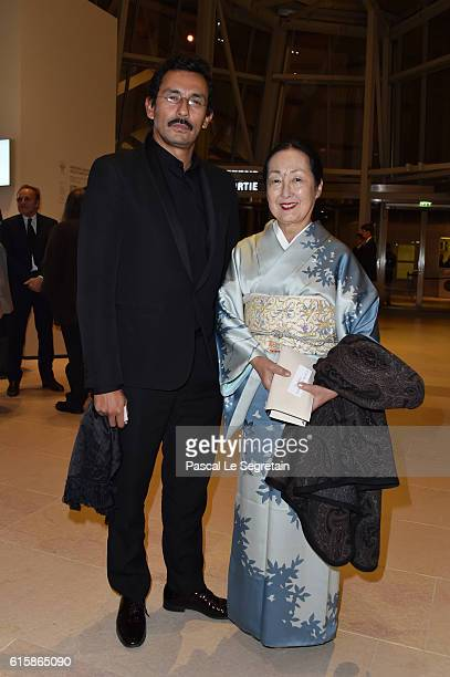Haider Ackermann and a guest attend a Cocktail for the opening of Icones de l'Art Moderne La Collection Chtchoukineat Fondation Louis Vuitton on...