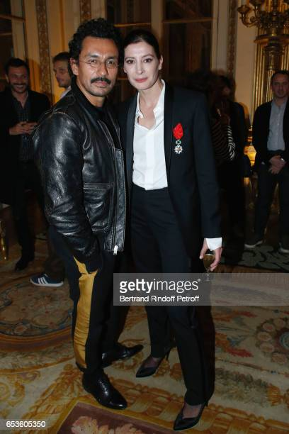 Haider Ackermann and MarieAgnes Gillot attend MarieAgnes Gillot is decorated 'Chevalier de lordre national de la Legion d'Honneur' at Ministere de la...