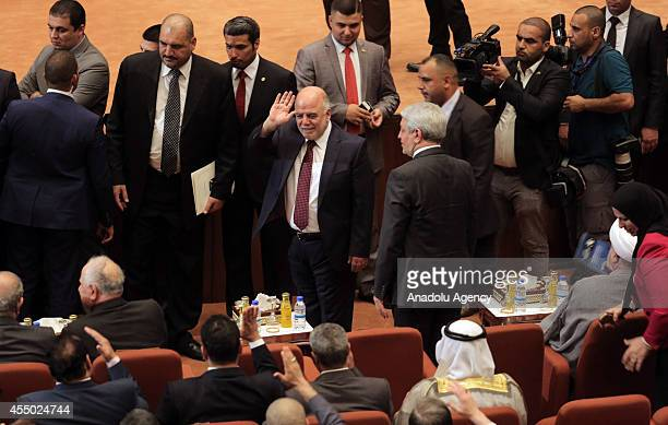 Haider alAbadi greets the new members of the parliament after the announcement of the new government in Baghdad Iraq on September 8 2014 A diverse...
