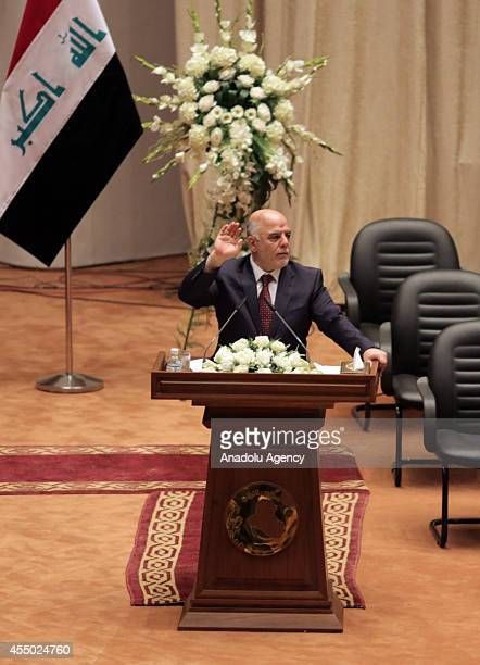 Haider alAbadi is at the rostrum greeting the new members of the parliament during the announcement of the new government in Baghdad Iraq on...