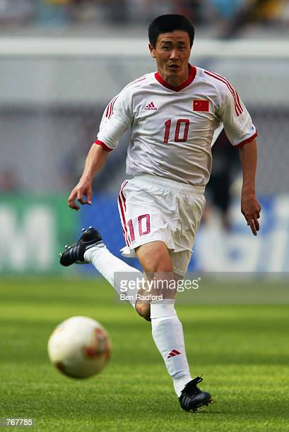 Haidong Hao of China runs with the ball during the FIFA World Cup Finals 2002 Group C match between Turkey and China played at the Seoul World Cup...