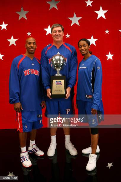 Haier Shooting Stars champions Chauncey Billups of the Detroit Pistons Swin Cash of the Detroit Shock and NBA legend Bill Laimbeer pose with their...