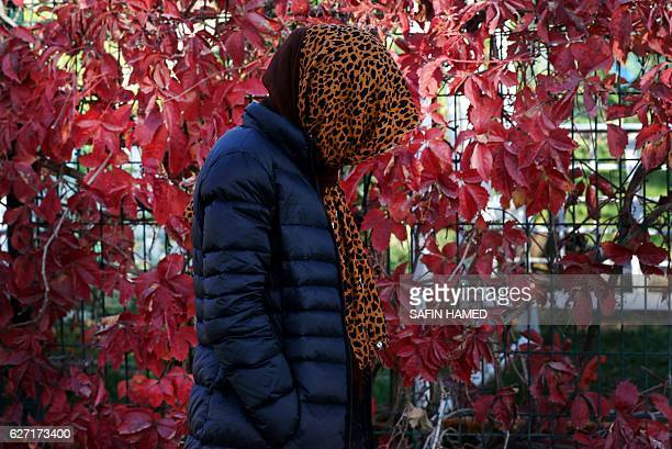 Haifa a 36yearold woman from Iraq's Yazidi community who was taken as a sex slave by Islamic State group fighters stands on a street during an...