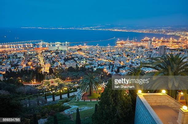 Haifa Bahai Gardens and bay at dusk