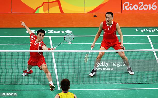 Haifeng Fu and Nan Zhang of China compete against Wee Kiong Tan and Shem V Goh of Malaysia during the Men's Badminton Doubles Gold Medal Match on Day...