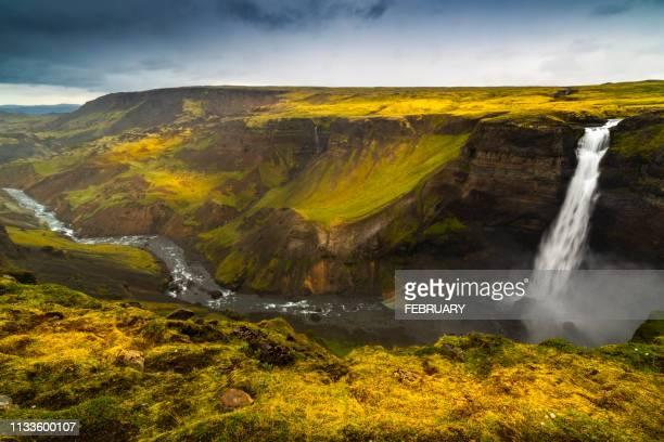 haifoss waterfall, summer,in iceland. - stimmungsvoller himmel stock-fotos und bilder
