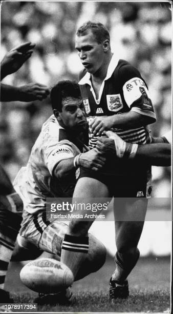 Hail the Field Marshal he sidesteps he passes he chipkicks and as here he grubbers Allan Langer Bronco captain and chief tactician chooses just one...