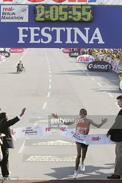 Haile Gebrselassie of Ethiopia crosses the finish line of the Berlin Marathon with an official time of 20556 on September 24 2006 in Berlin Germany