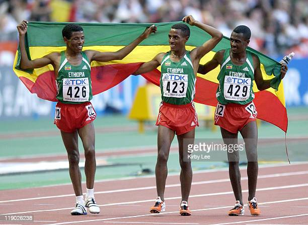 Haile Gebrsellasie Kenenisa Bekele and Sileshi Sihine take a victory lap after they swept the first three places in the 10000 meters in the IAAF...