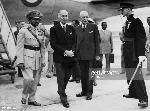 Haile Selassie Emperor of Ethiopia is greeted by officials upon his arrival in Ottawa Canada on a Royal Canadian Air Force plane 5th June 1954 From...
