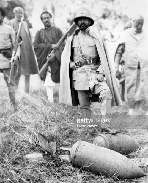 Haile Selassie emperor of Ethiopia visits the battle front at Dessye during war in Abyssinia He is standing on an unexploded bomb