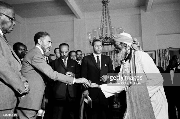 Haile Selassie I Emperor of Ethiopia greets a delegation of Rastafaian leaders at a reception on April 21 1966 in Kingston Jamaica