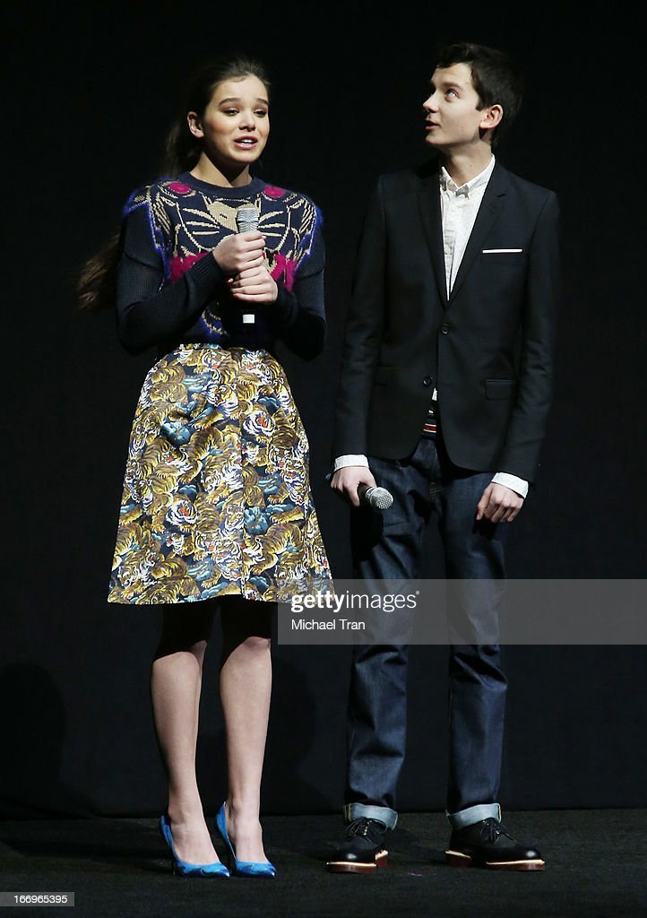 Hailee Steinfeld (L) and Asa Butterfield speak at a Lionsgate presentation to promote their upcoming film, 'Ender's Game' held at Caesars Palace during CinemaCon, the official convention of the National Association of Theatre Owners, on April 18, 2013 in Las Vegas, Nevada.
