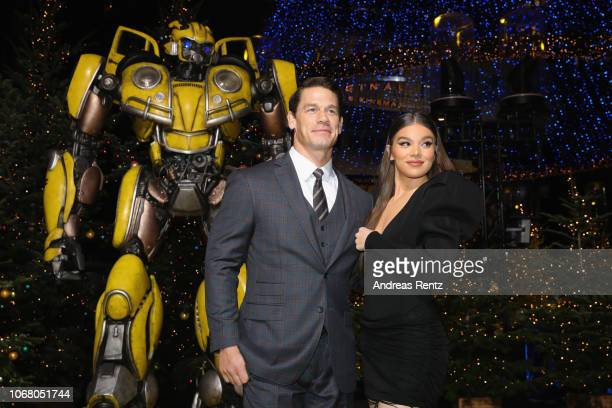 Hailee Steinfeld and John Cena attend a photo call in support of Paramount Pictures film a Buumblebee at Sony Centre on December 3 2018 in Berlin Ge