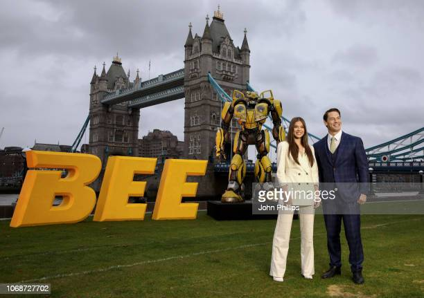 Hailee Steinfeld and John Cena attend a photocall in support of Paramount Pictures' film 'Bumblebee'â at Tower Bridge, Potters Field Park on December...