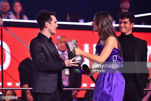 Hailee Steinfeld presents Brendon Urie with the Best Alternative award for Panic at the Disco on stage during the MTV EMAs 2018 on November 4 2018 in...