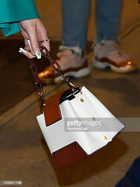Hailee Steinfeld purse detail departs the Late Show in Midtown on February 24 2020 in New York City