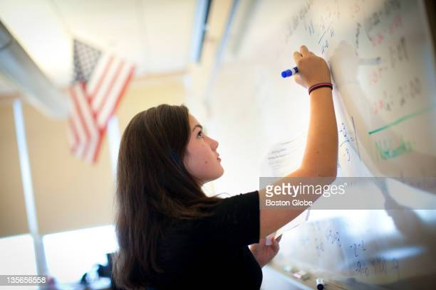 Hailey Adams completes a problem set on the board during her Algebra II class Due to the demographic shift in Hull's population school enrollment has...