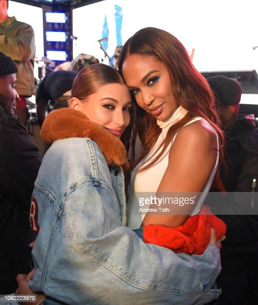 Hailey Baldwin and Joan Smalls attend the Levi's Times Square Store Opening on November 15 2018 in New York City
