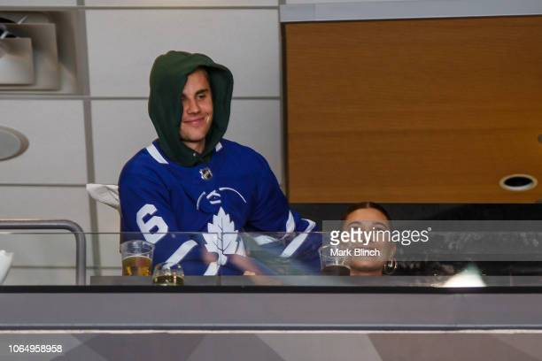 Hailey Baldwin and Justin Bieber take in the Toronto Maple Leafs game against the Philadelphia Flyers at the Scotiabank Arena on November 24 2018 in...