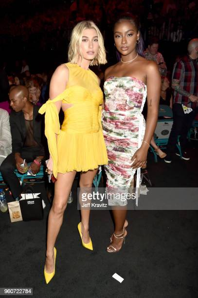 Hailey Baldwin and Justine Skye attend the 2018 Billboard Music Awards at MGM Grand Garden Arena on May 20 2018 in Las Vegas Nevada