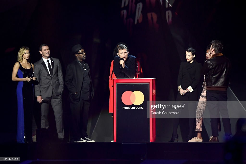 Hailey Baldwin and Luke Evans present Damon Albarn and Gorillaz with the British Group award at The BRIT Awards 2018 held at The O2 Arena on February 21, 2018 in London, England.