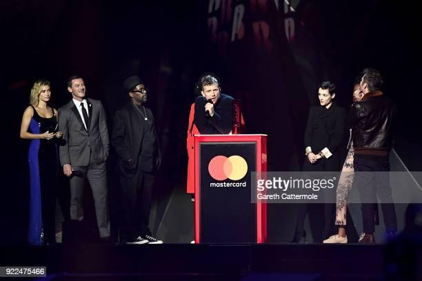 AWARDS 2018 *** Hailey Baldwin and Luke Evans present Damon Albarn and Gorillaz with the British Group award at The BRIT Awards 2018 held at The O2...