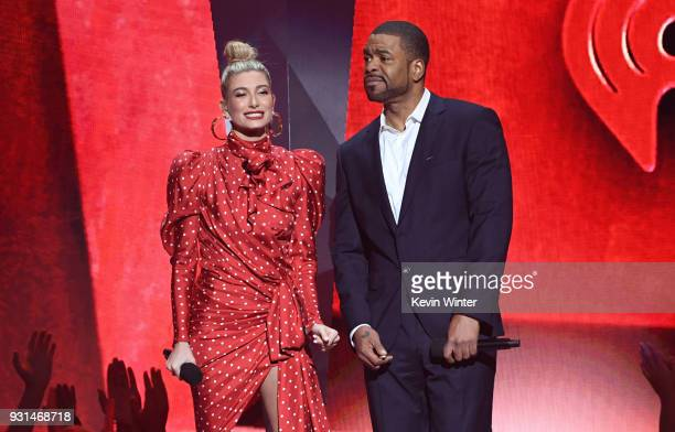 Hailey Baldwin and Method Man speak onstage during the 2018 iHeartRadio Music Awards which broadcasted live on TBS TNT and truTV at The Forum on...