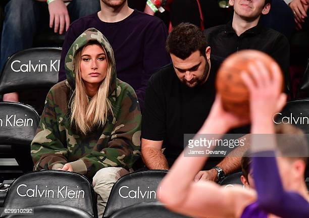 Hailey Baldwin and Zach Iser attend Brooklyn Nets vs Los Angeles Lakers game at Barclays Center on December 14 2016 in New York City