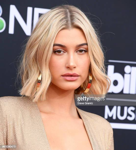 Hailey Baldwin arrives at the 2018 Billboard Music Awards at MGM Grand Garden Arena on May 20 2018 in Las Vegas Nevada