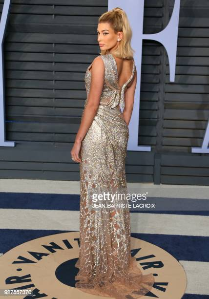 Hailey Baldwin attends the 2018 Vanity Fair Oscar Party following the 90th Academy Awards at The Wallis Annenberg Center for the Performing Arts in...