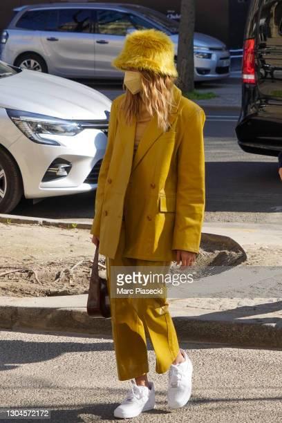 Hailey Baldwin Bieber is seen strolling on Avenue Montaigne on February 28, 2021 in Paris, France.