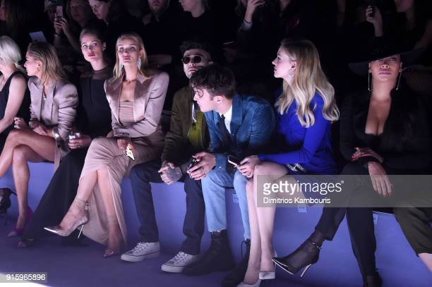 Hailey Baldwin Doutzen Kroes Rosie HuntingtonWhiteley Zayn Malik Anwar Hadid Nicola Peltz and La La Anthony attend the Tom Ford Fall/Winter 2018...
