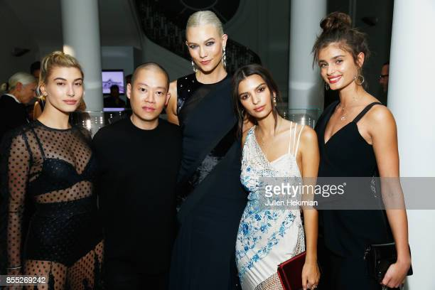 Hailey Baldwin, Jason Wu, Karlie Kloss, Emily Ratajkowski and Taylor Hill attend the Atelier Swarovski By Jason Wu dinner as part of the Paris...