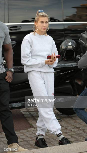 Hailey Baldwin listens to Justin Bieber playing a couple of songs with his guitar for her and fans outside the Buckingham Palace on September 18 2018...