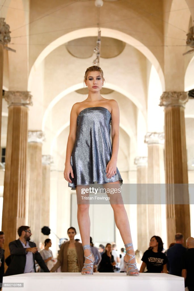 Hailey Baldwin poses backstage ahead of the Alberta Ferretti show during Milan Fashion Week Spring/Summer 2018on September 20, 2017 in Milan, Italy.