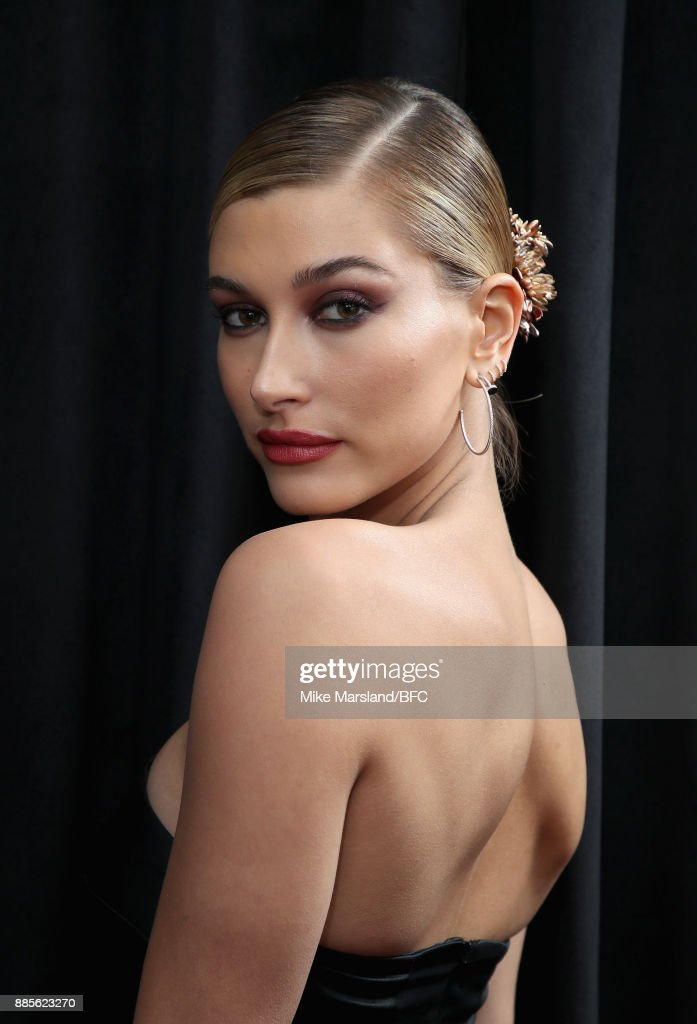 Hailey Baldwin poses in the winners room during The Fashion Awards 2017 in partnership with Swarovski at Royal Albert Hall on December 4, 2017 in London, England.