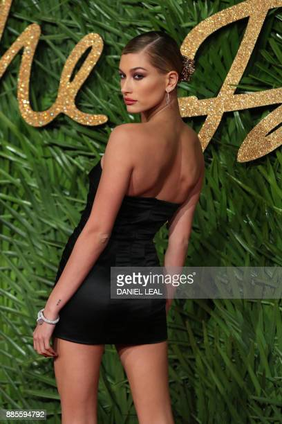 Hailey Baldwin poses on the red carpet upon arrival to attend the British Fashion Awards 2017 in London on December 4, 2017. / AFP PHOTO / Daniel...